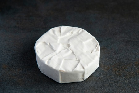 Cheese camembert or brie on dark background