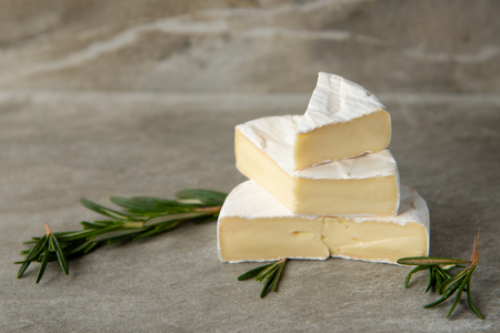 Cheese camembert or brie with fresh rosemary Reklamní fotografie