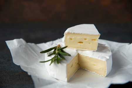 Cheese camembert or brie with fresh rosemary 写真素材
