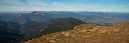 Panoramic view of idyllic mountain scenery in sunny day