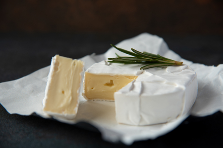 Cheese camembert or brie with fresh rosemary Imagens