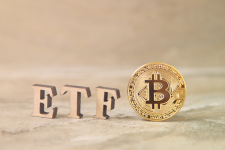 Bitcoin coin with ETF text on stone background 写真素材 - 121820613