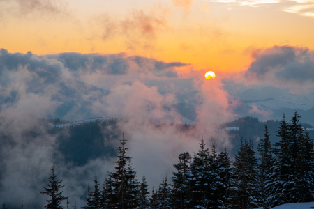 Amazing landscape in the winter mountains at sunrise