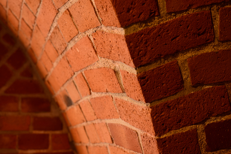 Old red brick wall with an arc background 写真素材