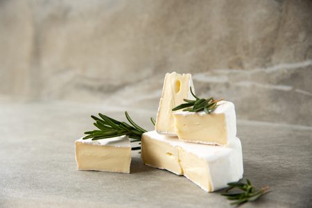 Cheese camembert or brie with fresh rosemary 写真素材 - 122659643