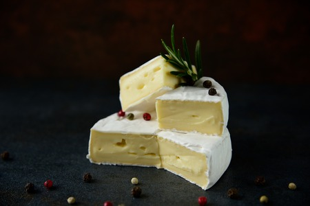 Cheese camembert or brie with fresh rosemary 写真素材 - 122601920