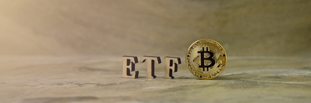 Bitcoin coin with ETF text on stone background 写真素材 - 122659723