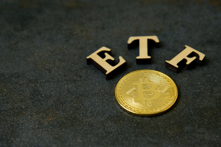 Bitcoin coin with ETF text on stone background 写真素材 - 122659722