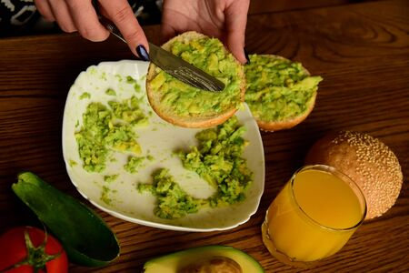 Making avocado toast on the home kitchen