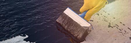 Worker applies bitumen mastic on the foundation