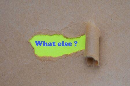 What else word written under torn paper. Standard-Bild