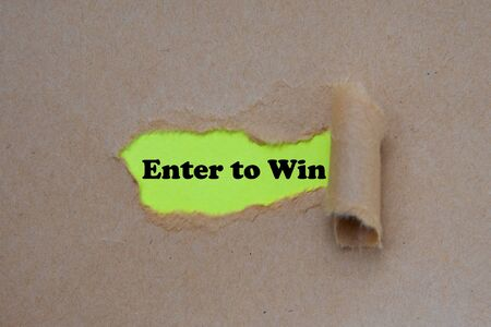 Enter to win word written under torn paper
