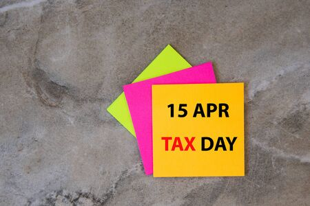 April 15 written on colorful sticky notes . New year calendar. Tax day.