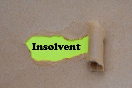 INSOLVENT word written under torn paper Image.