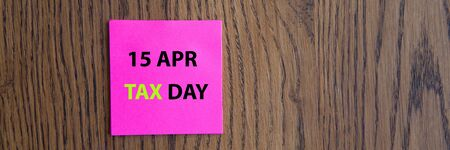 April 15 tax daywritten on colorful sticky notes Stock Photo