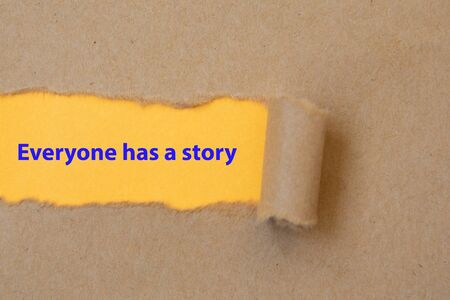 Everyone has a story, word written under torn paper
