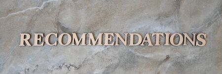 recommendations , writen wooden letters on stone background Stockfoto