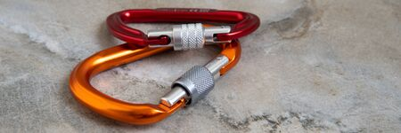 Climbing equipment - two  carabiners . Screw gate carabiners  on a marble top. Alpinism. Copy space. 版權商用圖片