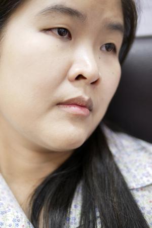 Head Shot Portrait of Young Asian Woman