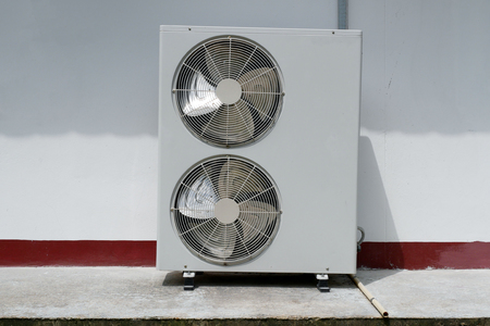 Double Fan Horizontal Outdoor Condensing Unit At a Wall Imagens