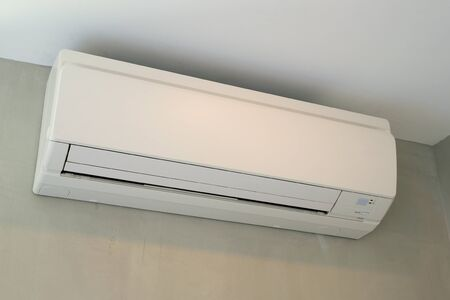 New Air Conditioner at a Grey Wall
