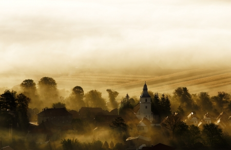 Small Transylvanian village in the morning sunshine photo