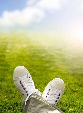 Sneakers in the grass with grass and sky background  photo