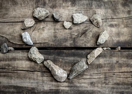 Stone heart on old wood texture Stock Photo