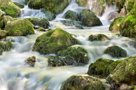 peacefull: Waterfall close up in forest with stones and stream Stock Photo