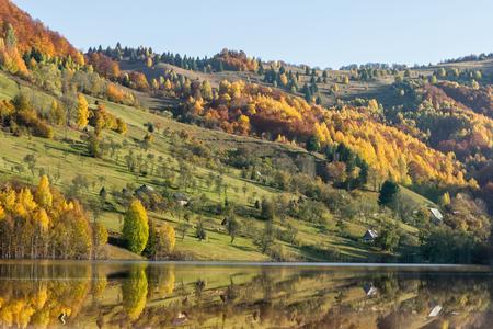 Reflection in lake - autumn hills in Transylvania