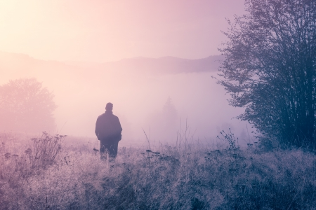 Lonely person in the morning mist  Landscape composition  photo