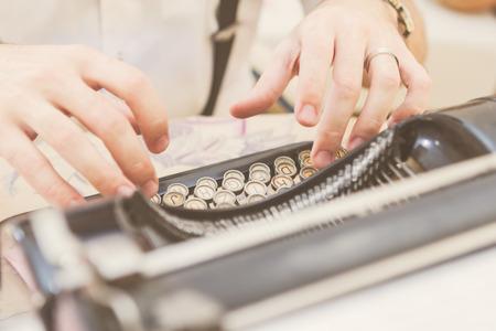 writers block: Hands writing on old typewriter