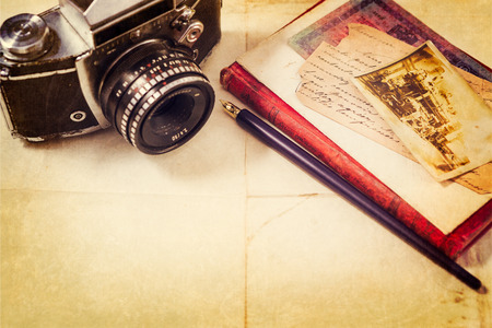 Background with vintage photo, money, postal card, and empty open book and camera