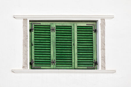Vintage green window on white wall