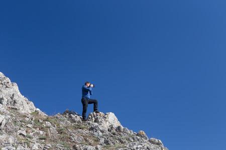 Amateur photographer with digital camera  Stock Photo