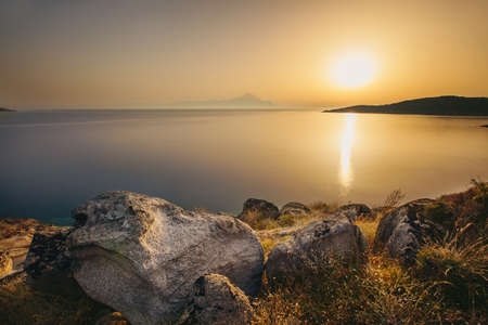 baclground: Sunrise in Greece with Athos mountain in the baclground, Halkidiki, Sykia - Europe