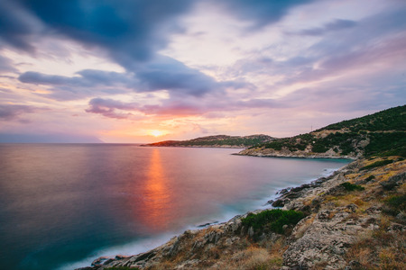 dramatic sunrise: Dramatic sunrise in Greece with beautiful clouds, Halkidiki, Sykia - Europe Stock Photo