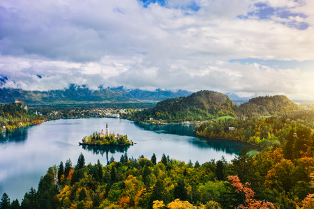 bled: Breathtaking long exposure aerial panoramic view of Lake Bled, Slovenia, Europe  Osojnica Stock Photo