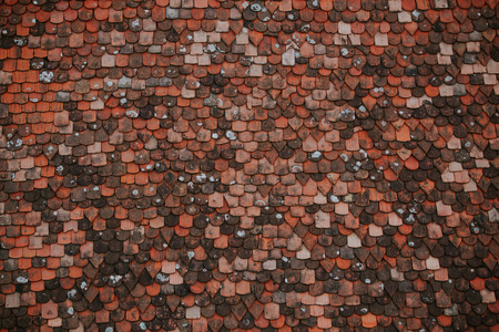 rooftiles: Colorful pattern of tiles on the roof. Medieval castle roof tiles texture.