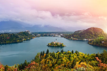 the long lake: Breathtaking long exposure aerial panoramic view of Lake Bled, Slovenia, Europe  Osojnica Stock Photo