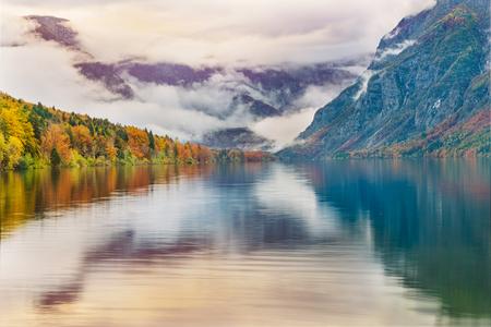 Colorful autumn dawn on the Bohinj lake in Triglav national park Slovenia, Alps, Europe.