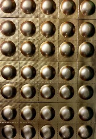 gold: The golden blister of pill Stock Photo