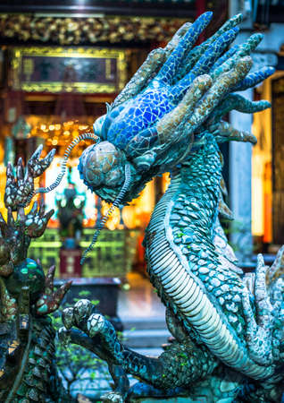 blue dragon: Blue dragon statue in a temple. Vietnam. Stock Photo