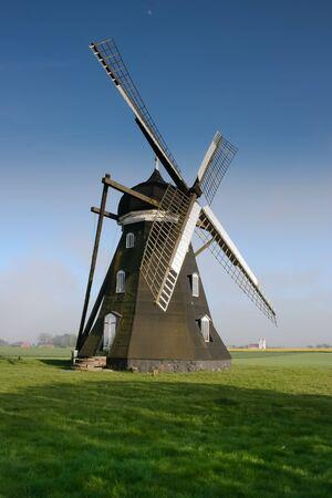 dutch: Old Dutch windmill against a blue sky