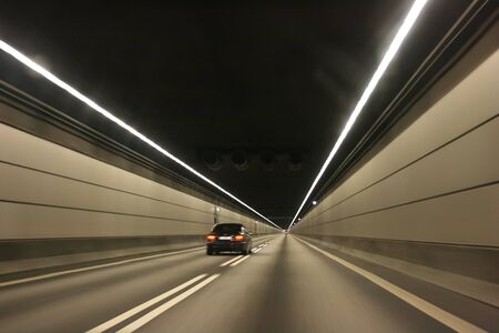 rou: The car in the undersea tunnel Stock Photo
