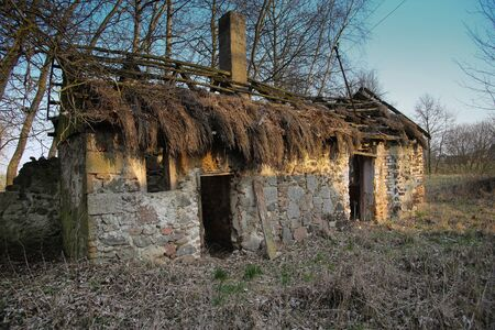 Old derelict crumbling cottage