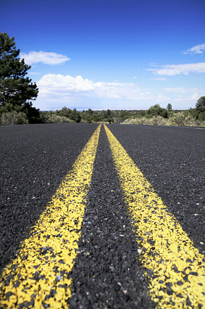 highway: Highway road leads off in to the distance. Stock Photo