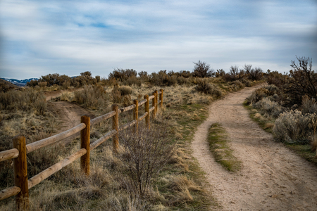A fencepost trail in the foothills of Idaho.