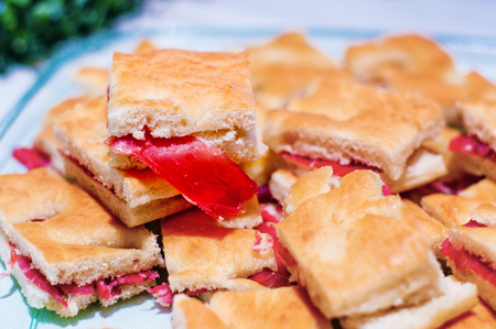 sweet and savoury: Spare warm focaccia stuffed with parma ham and mayonnaise flavored with herbs