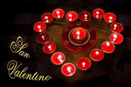 burning love: A heart of fire of love burning red candles